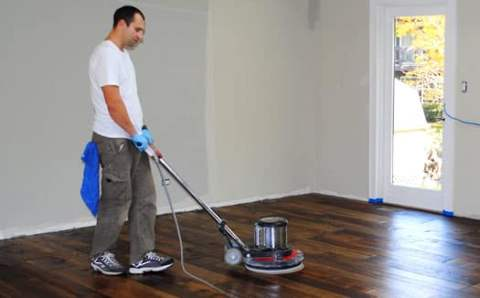 Buffing and re-coating a hardwood floor in Naperville, Il