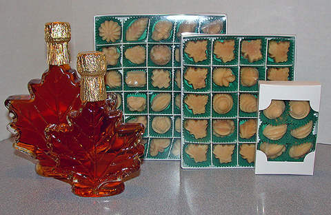 Maple syrup in glass maple leaf bottles, maple candy