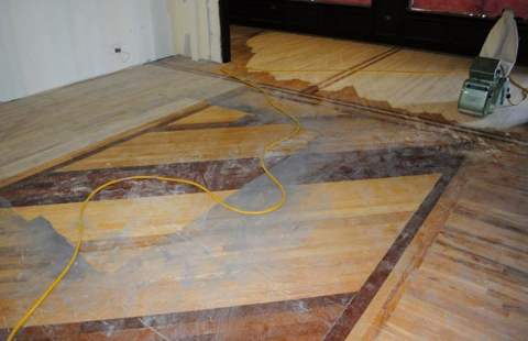 Sanding worn floor in store