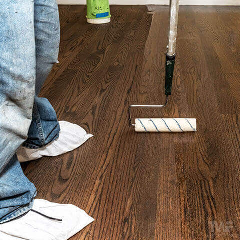 Coating dark stained floor