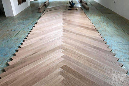Glue down a new Herringbone wood floor