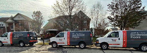 Hardwood Floor Refinishing Vans in front of Naperville House